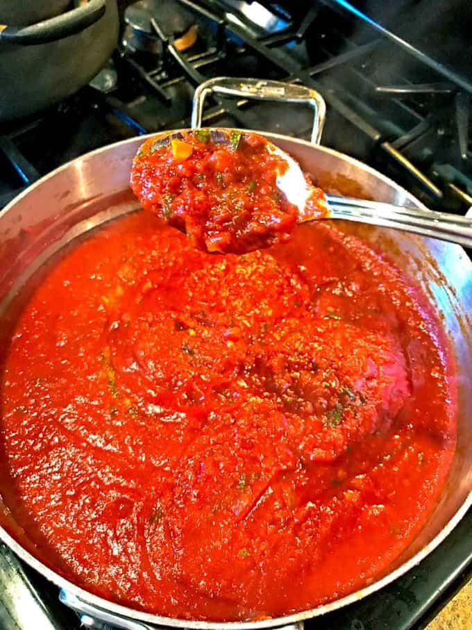 Homemade Red Sauce in Less then 40 Minutes in sauce pan with a spoonful in front
