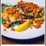 2 shrimp cakes on corn salad with pepper sauce