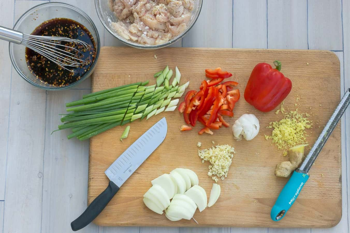 Thai Style Cashew Chicken ingredients on cutting board be chopped and prepared