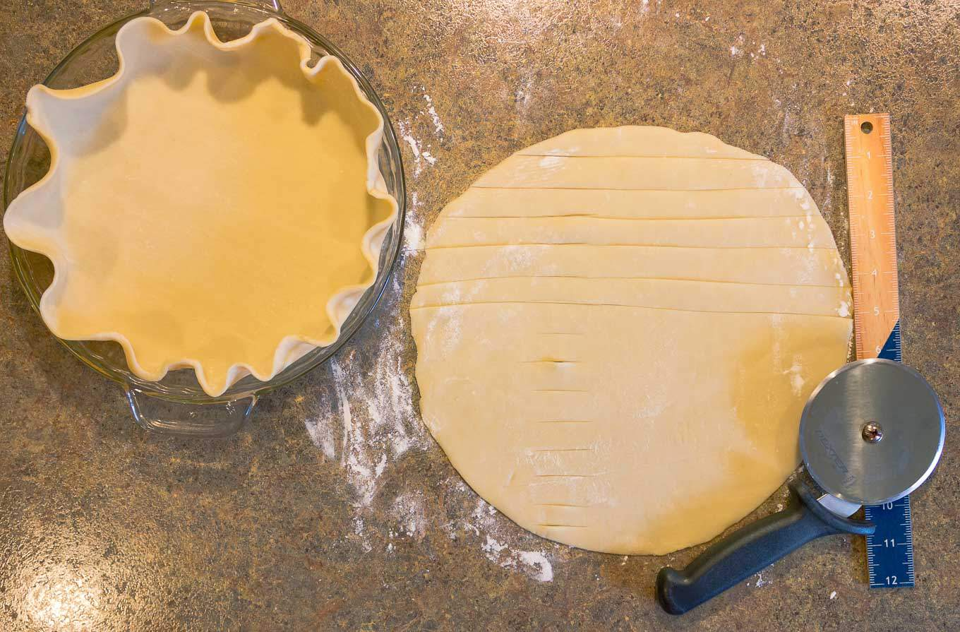 two pie crusts being prepared