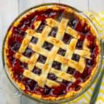 overhead shot of cherrypie with a yellow napkin