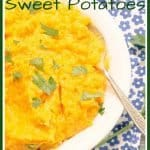 Roasted Savory Mashed Sweet Potatoes in white bowl with parsley garnish on a blue flower napkin