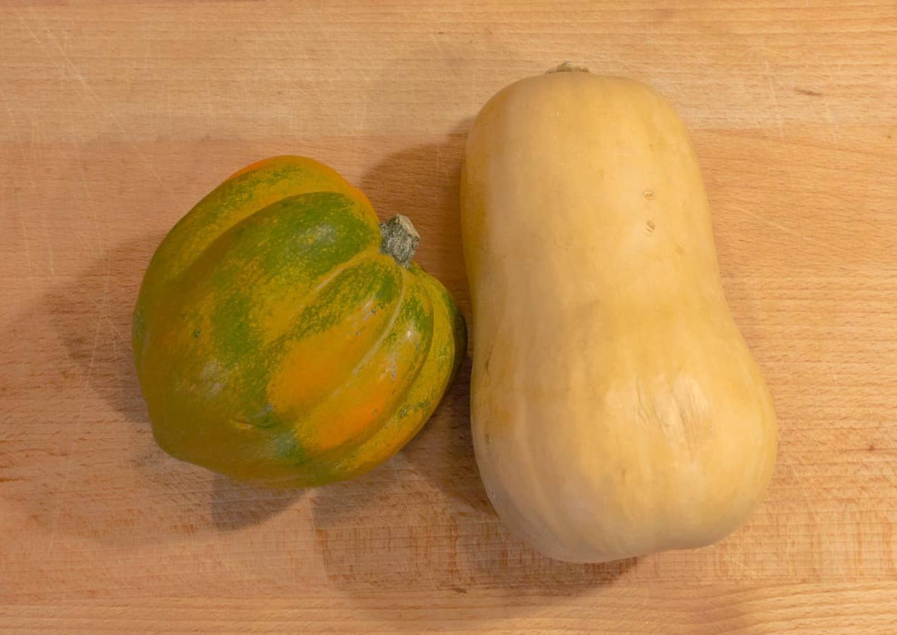 whole squashes shown for Easy Roasted Butternut & Acorn Squash with Sage Brown Butter recipe
