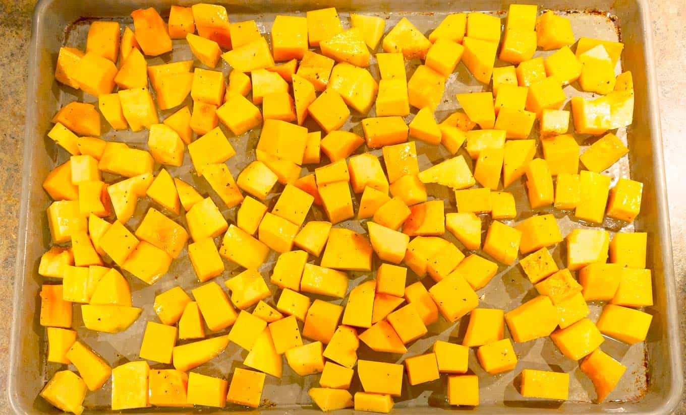 cubed squash for Easy Roasted Butternut & Acorn Squash with Sage Brown Butter on a cookie sheet