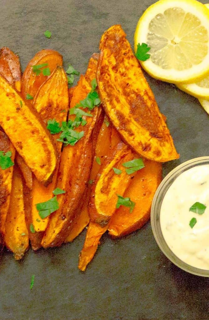Oven Baked Sweet Potato Fries & Garlic Aioli! on black slate with parsley