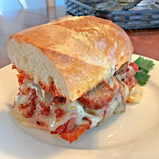 The Bomb Italian Sausage Sandwich on white plate