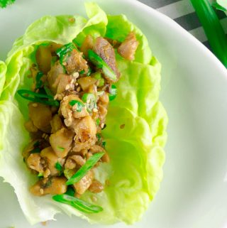 one Asian Chicken Lettuce Wrap on white plate