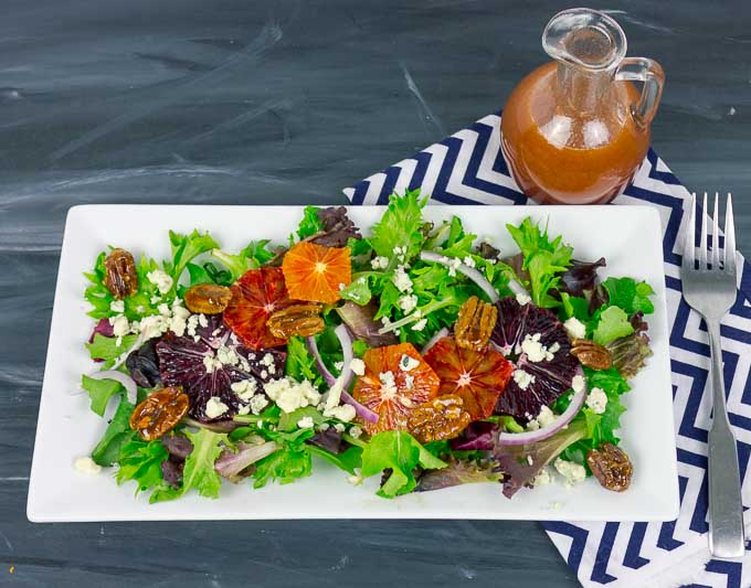 Blood Orange Citrus Salad with Orange Vinaigrette, striped napkin and fork