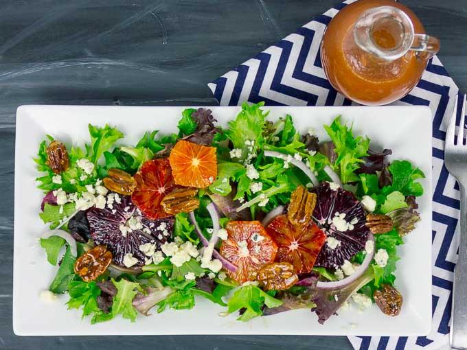 Blood Orange Citrus Salad with Orange Vinaigrette with stiped napkin and fork
