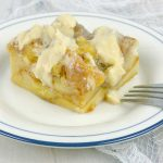 Irish Cream Custard Bread Pudding on white plate with fork