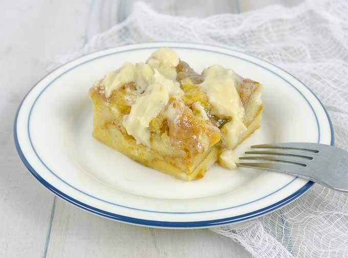 Irish Cream Custard Bread Pudding on white plate with fork