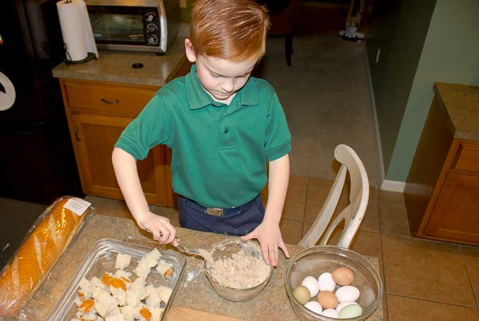 child helping to make bread pudding