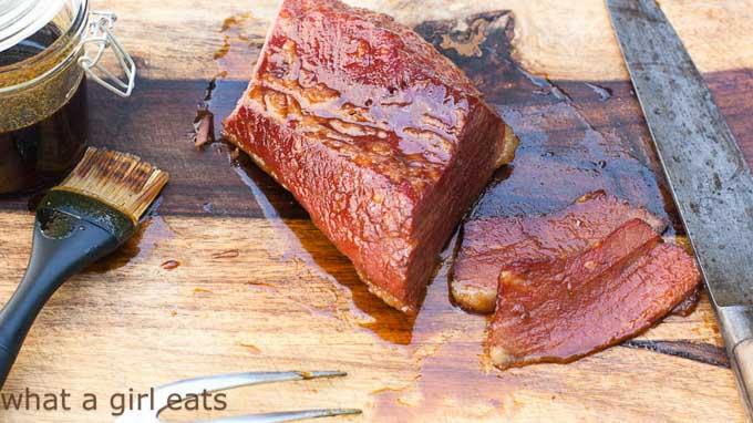 Triple Whiskey Glazed Corned Beef on wooden board