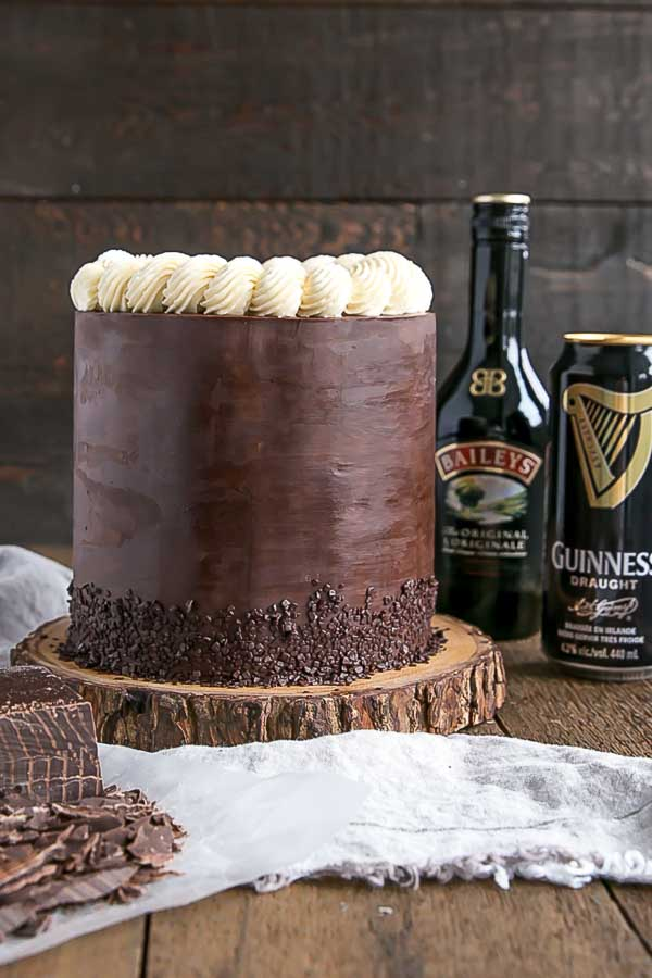 Baileys & Guinness Cake with baileys and guinness in the background