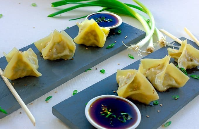 Shrimp Dumpling Potstickers on black slate with dipping sauce