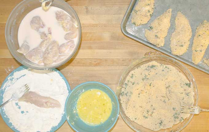 flour, egg, and breading prep stations for Healthy Buttermilk Baked Chicken Strips
