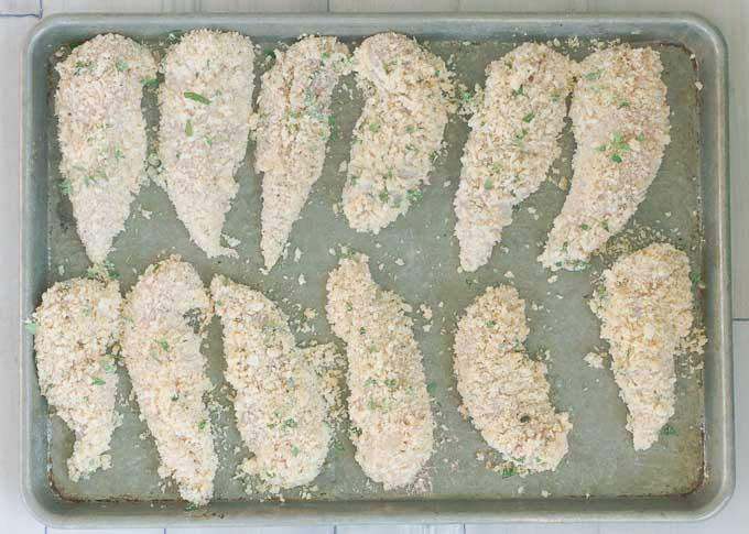 Breaded chicken strips ready to be cooked.