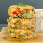 3 Baked Fresh Salmon Cakes (Salmon Patties) on wood board with spicy remoulade