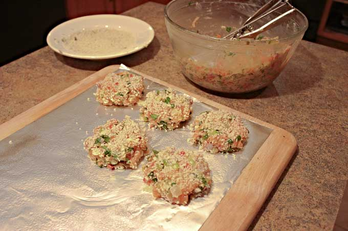 raw Salmon Cakes on foil being prepared for the oven