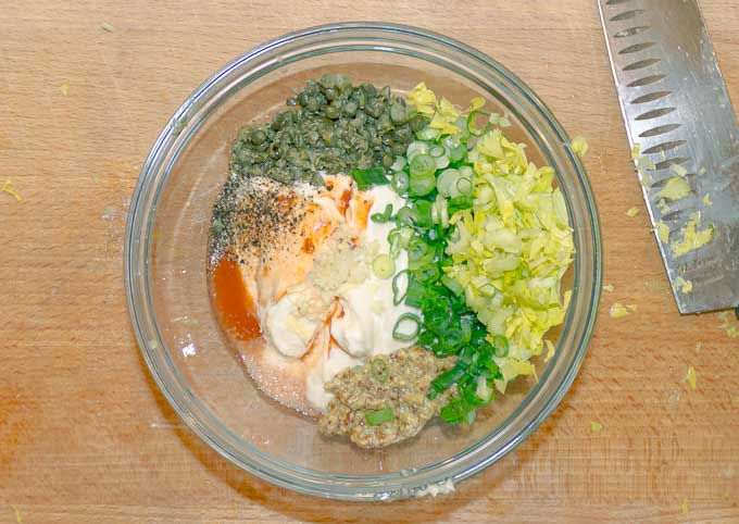 clear bowl with ingrediants of Spicy Remoulade Sauce ready to be mixed