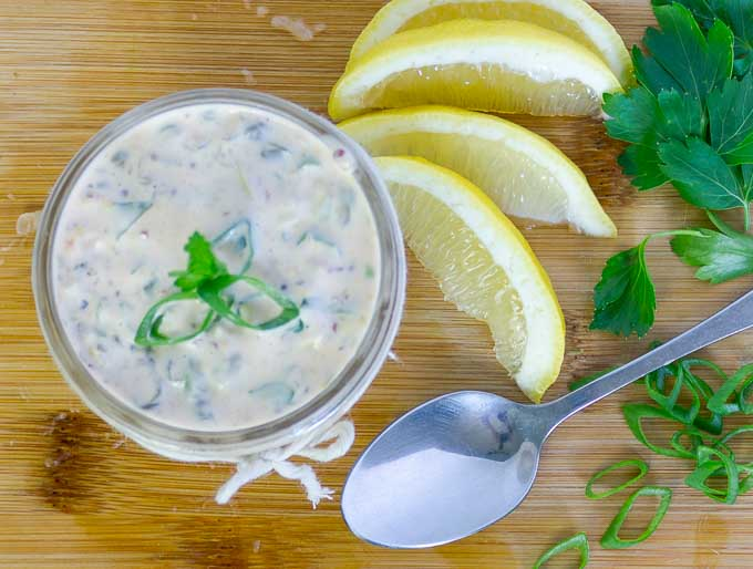 Spicy Remoulade Sauce in glass jar with parsly and green oniongarnish