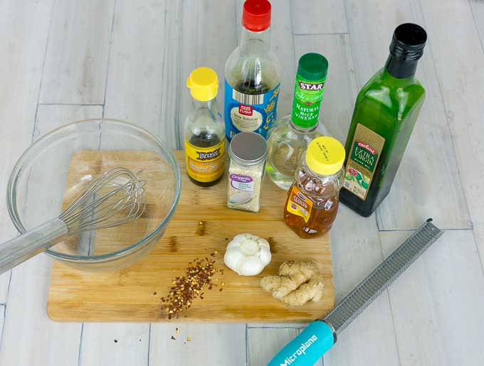 ingrediants and a cutting board for sesme ginger dressing