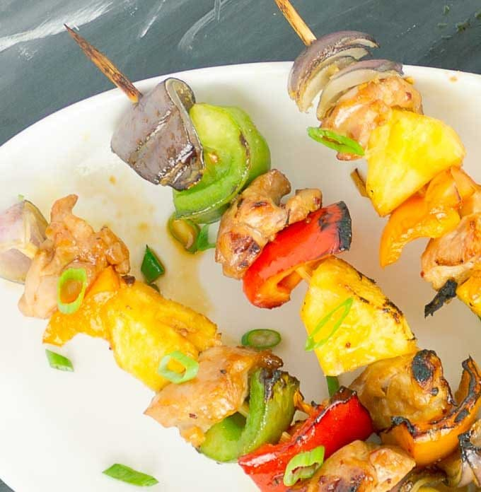3 Grilled Pineapple Teriyaki Chicken Kabobs on white platter