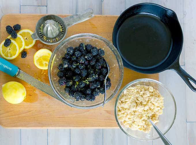 ingrediants for Cast Iron Skillet Blackberry Crumble on a wooden cutting board