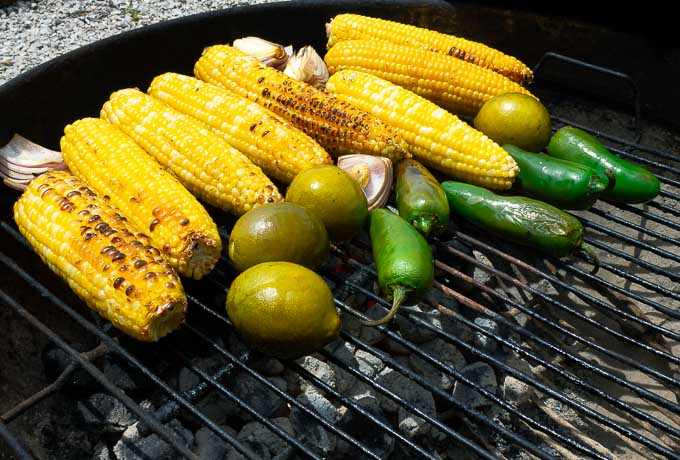corn, limes, jalepenos, and onion on the grill