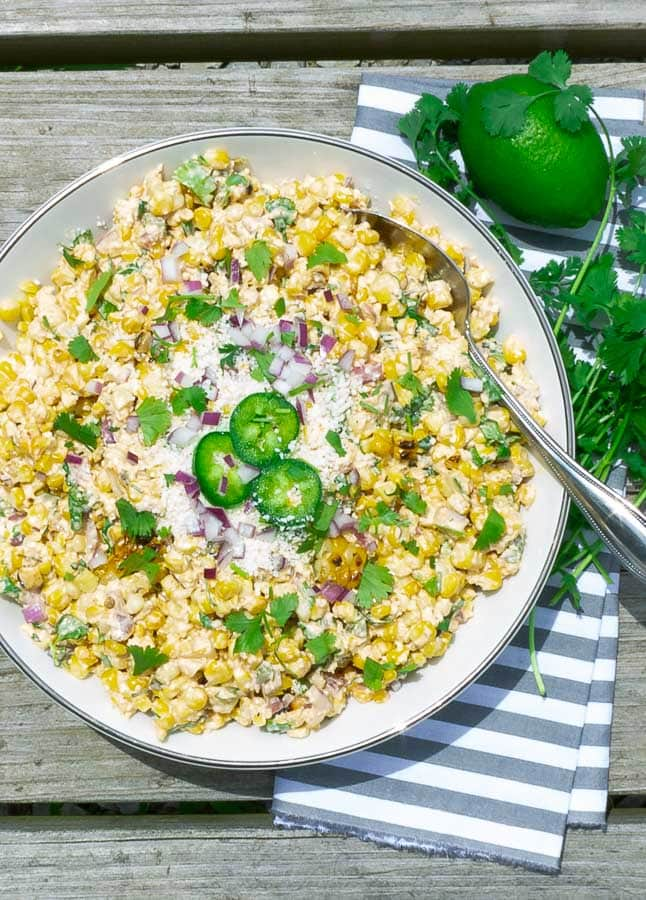 white bowl of grilled street corn salad