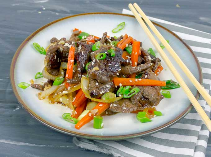 white plate and chopsticks with Sesame Beef Stir Fry
