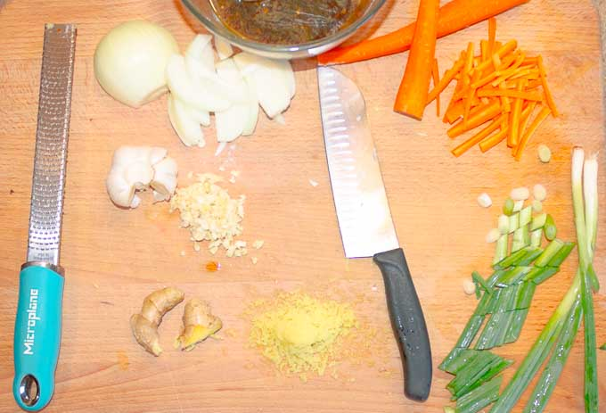 carrots and onions being chopped for Sesame Beef Stir Fry