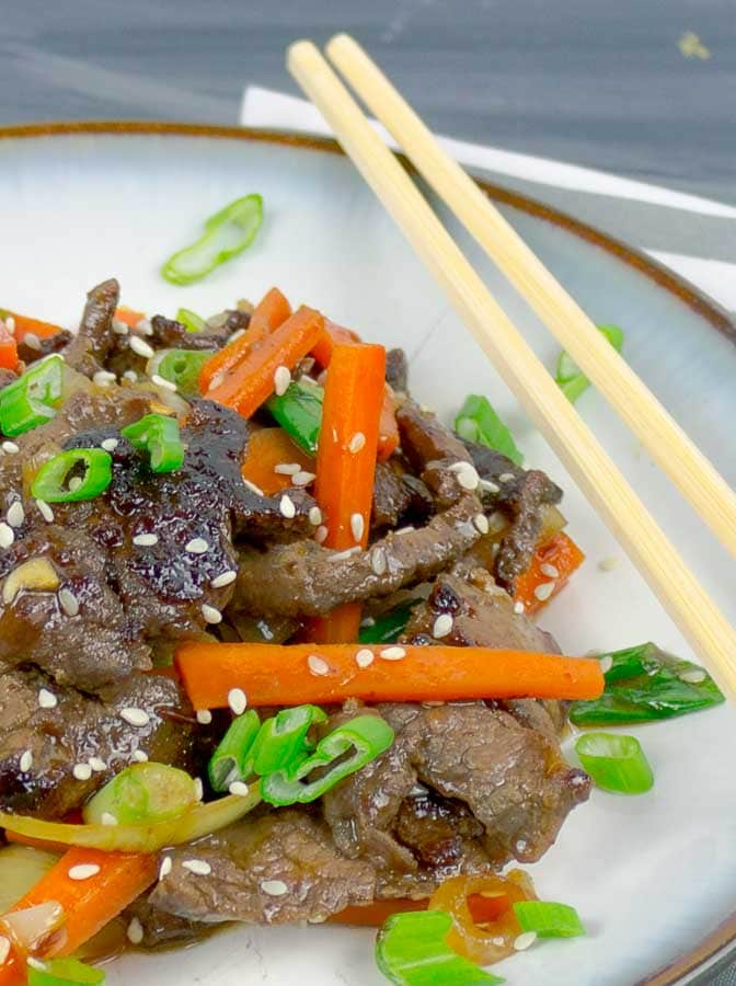 right side of a white plate of Sesame Beef Stir Fry