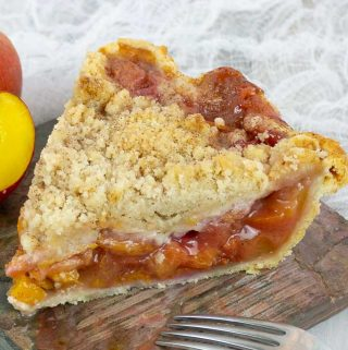 A piece of Fresh Peach Pie With Crumb Topping