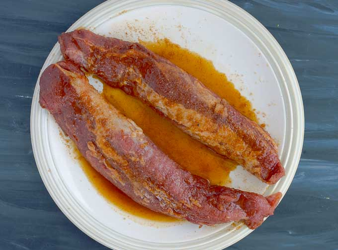 2 pork tenderloins with smokey rub resting