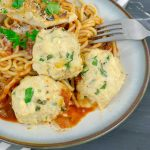 three Baked Chicken Ricotta Meatballs on pasta and red sauce