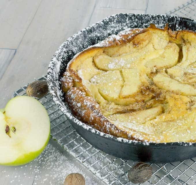 Caramel Apple Dutch Baby in a cast iron skillet