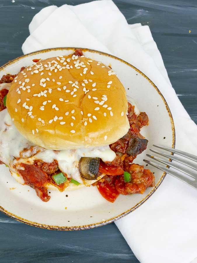 pizza sloppy joe sandwich on white plate