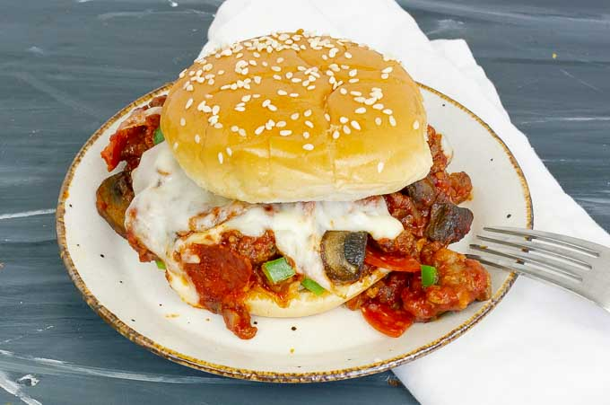 pizza sloppy joe sandwich on white plate