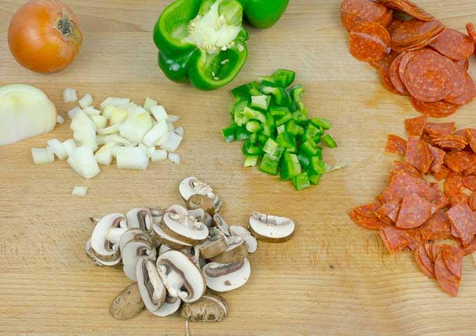 ingrediants for pizza sloppy joes on wooden board