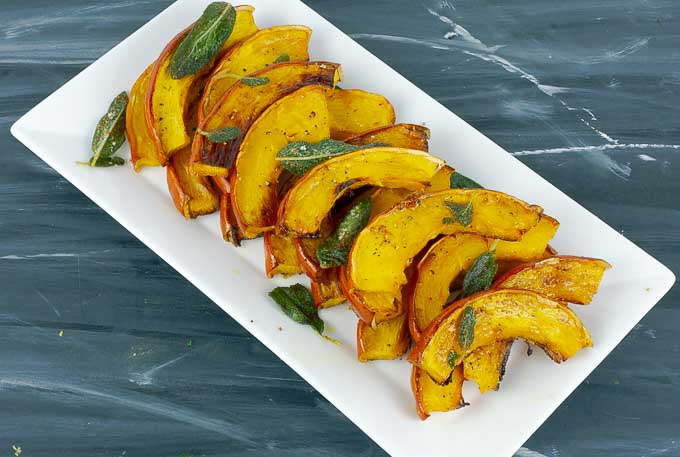 white serving tray of Roasted Pumpkin with Brown Butter and Crispy Sage