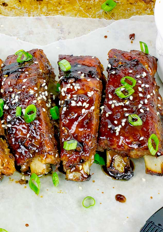 three Sticky Asian Baked Pork Ribs on baking sheet