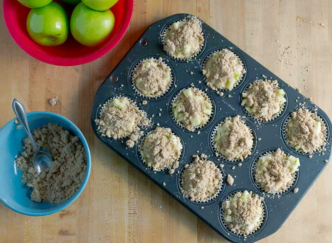 streusel on uncooked apple streusel muffins