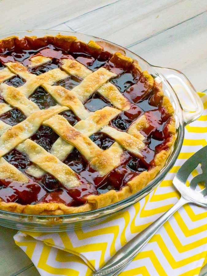 right side of The Best Cherry Pie Recipe with Homemade Filling in glass pie plate