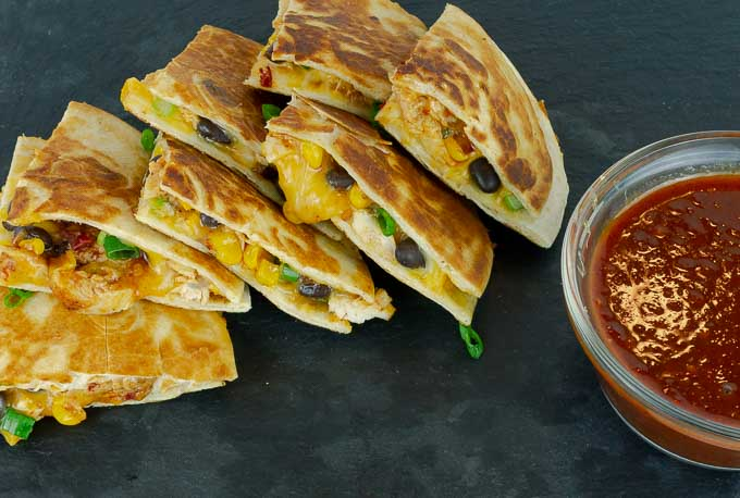 Barbecued Chicken Quesadillas with barbecue sauce on the side