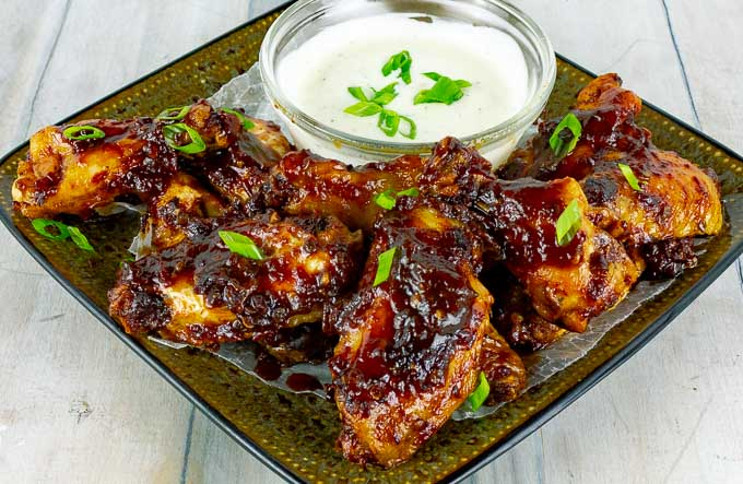 Baked Chipotle Barbecue Wings on square plate with ranch