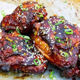 three Sticky Asian Grilled Chicken Thighs on white background