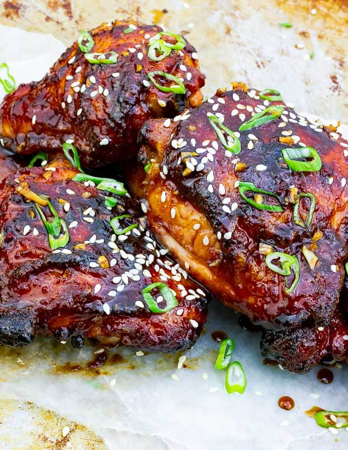 three pieces of Sticky Asian Grilled Chicken Thighs on white background