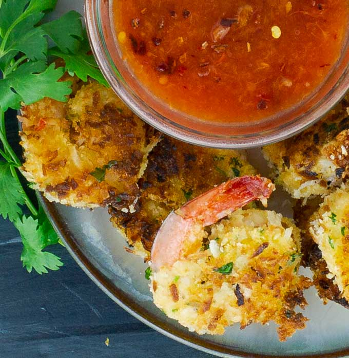 Coconut Shrimp on plate with bowl of peach chili sauce