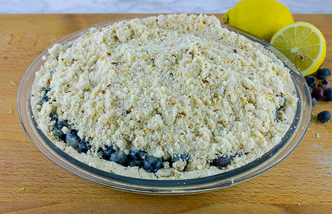 Fresh Blueberry Almond Crumb Pie ready to be baked